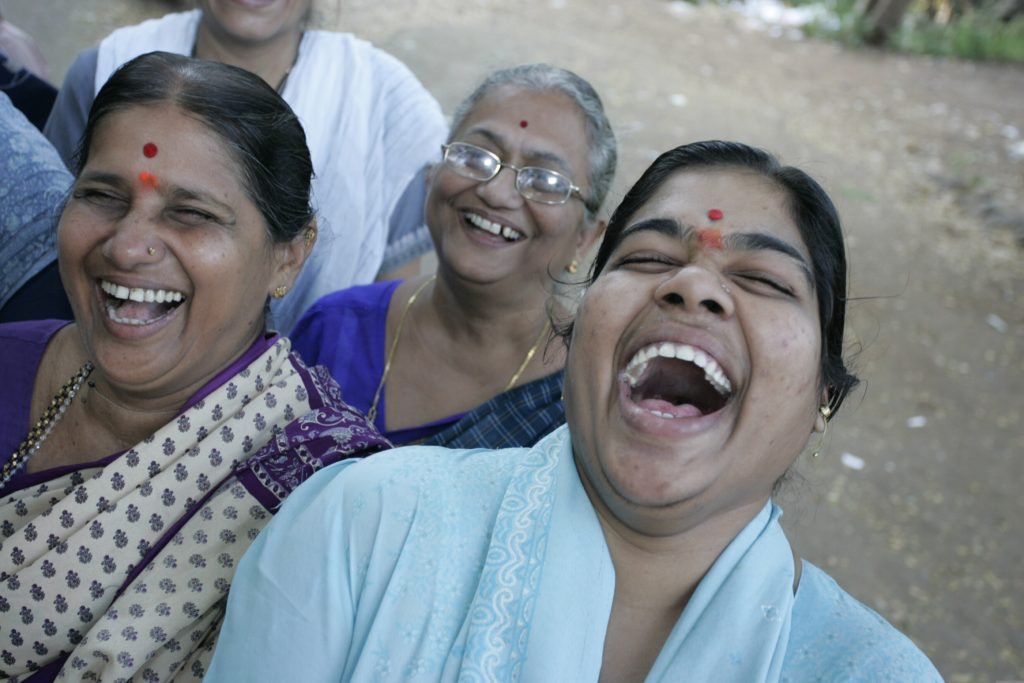 """Sushma Palav regulary gets into fits of hysterics during her Laughter Yoga session in a north Mumbai park, India. """"My good mood lasts me all day long"""" she tells me. Mumbai, India. 27/10/06"""